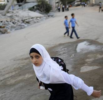 Image: Palestinian students head for their first day of the new school term