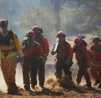 Image: Inmate firefighters with the Eel River Conservation Camp march to work on a containment line at the King Fire in White Meadows