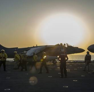 Image: An AV-8B Harrier jet launching from the flight deck of the amphibious assault ship U.S.S. Makin Island during flight operations in the Arabian Gulf