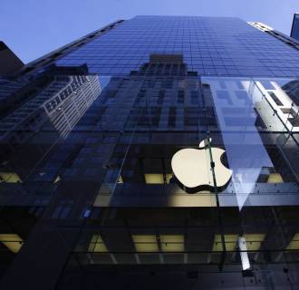 Apple's shares slid Thursday, dragging stock markets down with them.