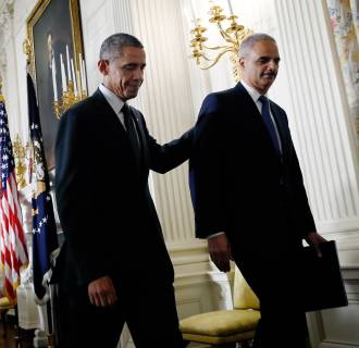 Image: President Barack Obama walks away with Attorney General Eric Holder