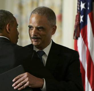 =U.S.  Attorney General Holder embraces President Obama after the president announced Holder's resignation at the White House in Washington