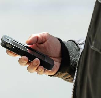 Image: Man uses smart phone