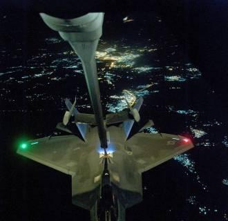 Image: U.S Air Force KC-10 Extender refuels an F-22 Raptor fighter aircraft
