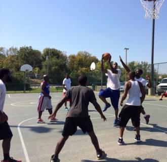 Image: Locals play basketball in Ferguson, Missouri