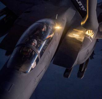 Image: A F-15E Strike Eagle receives fuel from a KC-135 Stratotanker over northern Iraq after conducting airstrikes in Syria