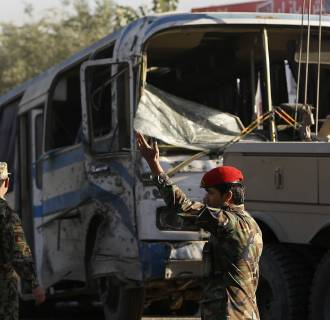 Image: Afghan National Army soldiers (ANA) arrive at the site of a suicide bomb attack in Kabul