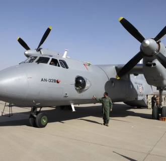 Iraqi army soldiers inspect an aircraft in Baghdad.