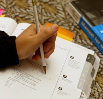 Image: A student uses a Princeton Review SAT Preparation book to study for the test