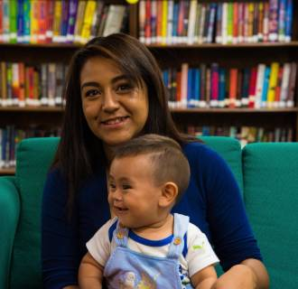 Image: Carina Ramirez holds her son Seth in Los Lunas, New Mexico.