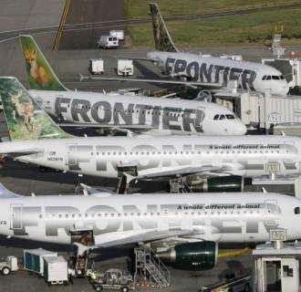 File photo of Frontier Airlines planes at their gates at the Denver airport