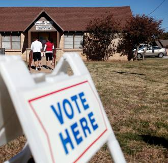 Image: Voters exit a polling location after voting on November 6, 2012 in Lipan, Texas.