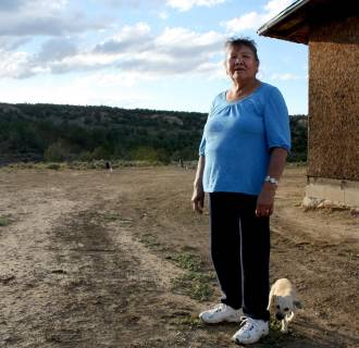 Image: Mary Shay stands outside the two-room hut that she shares with her sister on a part of the Navajo Reservation about 9 miles from Gallup, New Mexico, the closest town off the reservation.