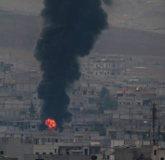 Image: Thick smoke and flames from a fire rises following a strike in Kobani