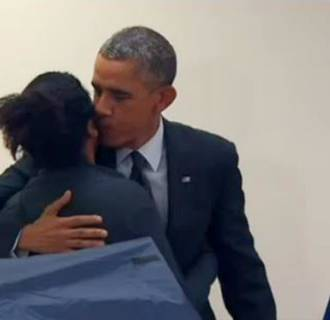 Image: President Obama gives a kiss to a voter in Chicago.