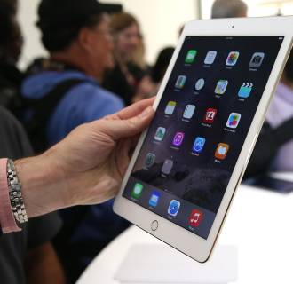 Image:  An attendee inspects new iPad Air 2