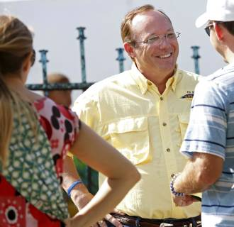 Image: Senate candidate Rob Maness speaks with voters during the Louisiana Gumbo Festival in Chackbay