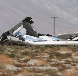 Image: A piece of debris is seen near the scene of the crash of Virgin Galactic's SpaceShipTwo near Cantil, California