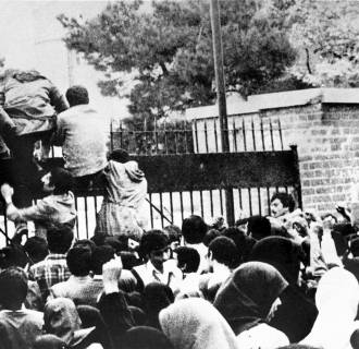 Image: Iranian students climb over the wall of the US embassy in Tehran Nov. 4, 1979