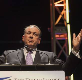 Image: File photo of former Arkansas Governor Huckabee speaking at the Family Leadership Summit in Ames
