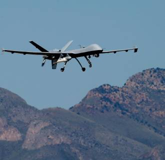 Image: A U.S. Customs and Border Patrol drone aircraft lifts off at Ft. Huachuca in Sierra Vista, Ariz.