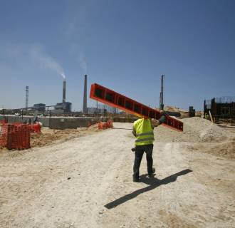 A labourer works at the construction site of Dorad, a private power plant in Ashkelon