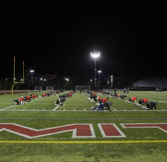 Image: Massachusetts Institute of Technology (MIT) Engineers football players attend practice in Cambridge