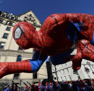 Image: The Spiderman balloon makes its down Central Park West during the 87th Macy's Thanksgiving Day Parade in New York