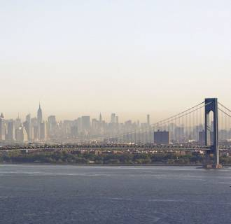 Image: A layer of smog can be seen above Manhattan through the Verrazano-Narrows Bridge in New York
