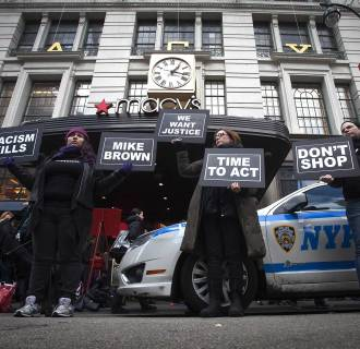 Image: Protesters demonstrate outside of Macy's in Herald Square during the Black Friday shopping day in New York