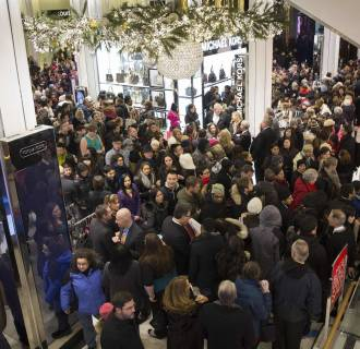 Image: Shoppers enter Macy's to kick off Black Friday sales in New York