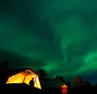 Image: The Aurora Borealis (Northern Lights) is seen over a mountain camp north of the Arctic Circle, near the village of Mestervik
