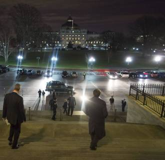 Image: Members of the U.S. Congress depart after passage of spending bill on the House floor at the U.S. Capitol in Washington