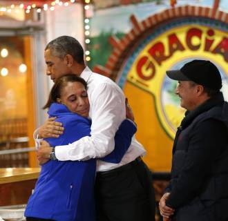 Image: Obama hugs restaurant owner during visit to the restaurant in Nashville