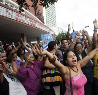 Image: People cheer for the