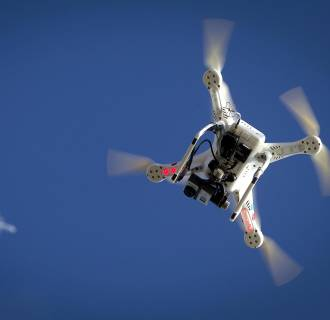 Image: Airplane flies over a drone during the Polar Bear Plunge on Coney Island in the Brooklyn borough of New York