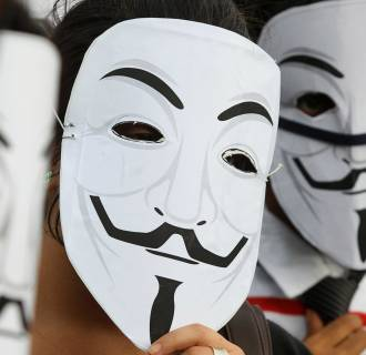 Image: Activists supporting the group Anonymous
