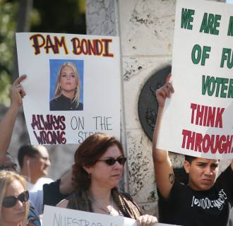 Image: Activists Demonstrate Against FL's Attorney General Pam Bondi Backing Of Lawsuit Against Obama's Immigration Action
