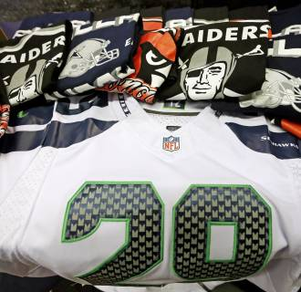 Counterfeit NFL merchandise is displayed during a counterfeit ticket and merchandise news conference for Super Bowl XLIX.