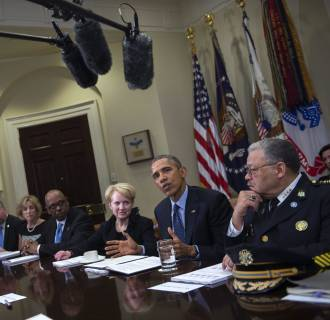 Image: President Obama meets with members of his Task Force on 21st Century Policing.