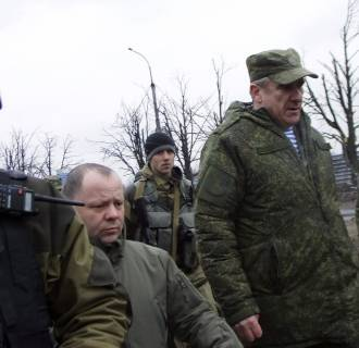Image: Russian Lieutenant General Alexander Lentsov arrives to visit the city's airport in Donetsk