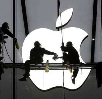 Apple is replacing AT&T in the iconic Dow Jones Industrial Average.