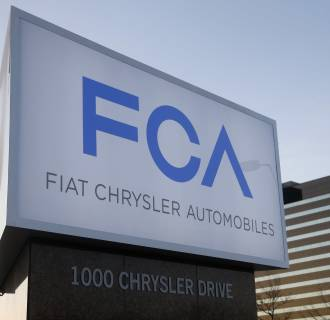 Image: A new Fiat Chrysler Automobiles sign is pictured  at Chrysler Group World Headquarters in Auburn Hills, Michigan