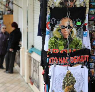 Image: Strongman Putin: T-shirts for sale at a souvenir shop in Yalta,where many remain defiant after international sanctions following theRussian annexation of Crimea.