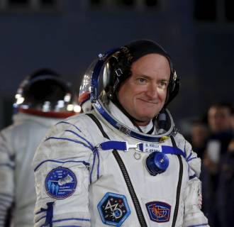Image: NASA astronaut Scott Kelly walks after donning space suit at the Baikonur cosmodrome