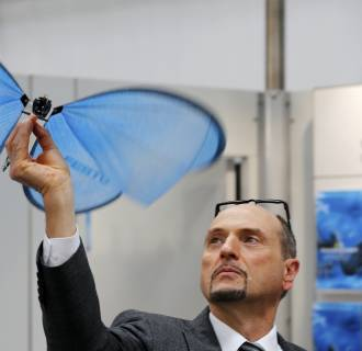 Image: Employee presents the eMotion Butterfly, a collision-free flying object, developed by German FESTO company, at the world's largest industrial technology fair, the Hannover Messe, in Hanover