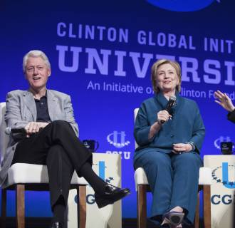 Image: File photo of Bill, Hillary and Chelsea Clinton, discussing Clinton Global Initiative University during closing plenary session on second day of 2014 Meeting of Clinton Global Initiative University at Arizona State University in Tempe