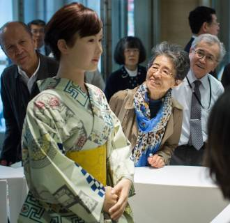 Image: Shoppers view and take photographs of humanoid robot 'Aiko Chihira'