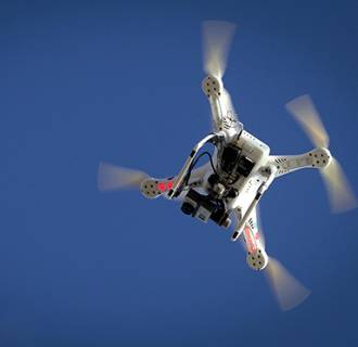 Image: File photo of airplane flying over a drone