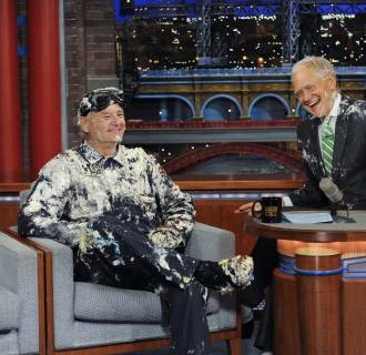 Image: Bill Murray jumps out of giant cake, when he makes his final appearance on the Late Show with David Letterman